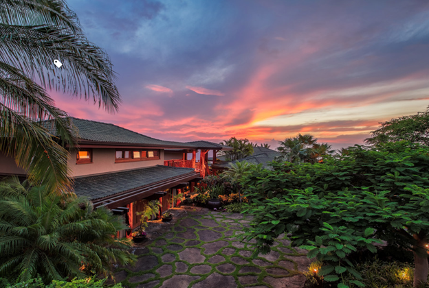Custom home from Hawaii Island Architects lit up at night